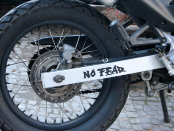 No Fear written on motorcycle wheel for How to Get Past Your Fear by Joanne Zippel for Zip Creative